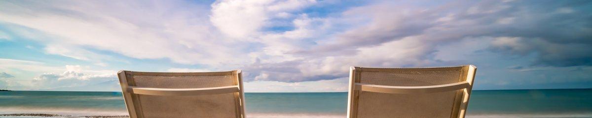 Empty white plastic sunbeds on Tsilivi Beach