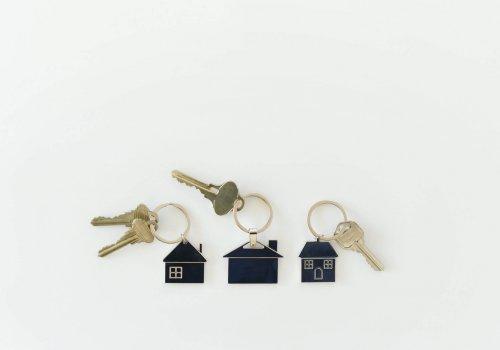 Housing Market concept - keys on house key rings, real estate, homes neighborhood equity buy sell